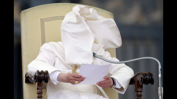 September 26: A gust of wind blows Pope Benedict XVI