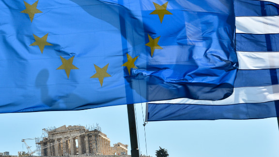 October 12: The European Union wins the Nobel Peace Prize while grappling with the worst crisis since its founding -- devastating debt and the threat of disintegration. The flag of the 27-nation union, left, flies alongside the flag of debt-ridden Greece in front of the Acropolis in central Athens.