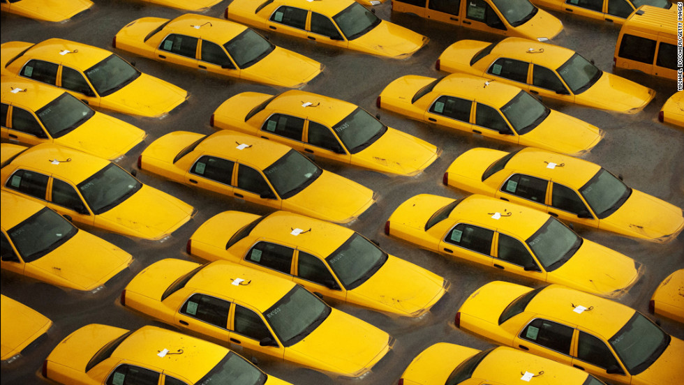 <strong>October 30: </strong>Taxis sit in a flooded lot in Hoboken, New Jersey, after Superstorm Sandy devastated the region. The storm slammed ashore near Atlantic City, New Jersey, after forming in the Caribbean and sweeping northward, killing 182 people from Haiti to Canada.