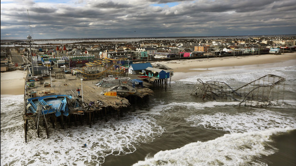 October 31: Waves break in front of a destroyed amusement park wrecked by Superstorm Sandy in Seaside Heights, New Jersey.