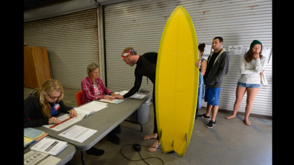 November 6: Mike Wigart picks up his ballot at a polling station in the garage of the Los Angeles County lifeguard headquarters. Americans headed to the polls to vote in the race between President Barack Obama and Republican candidate Mitt Romney.