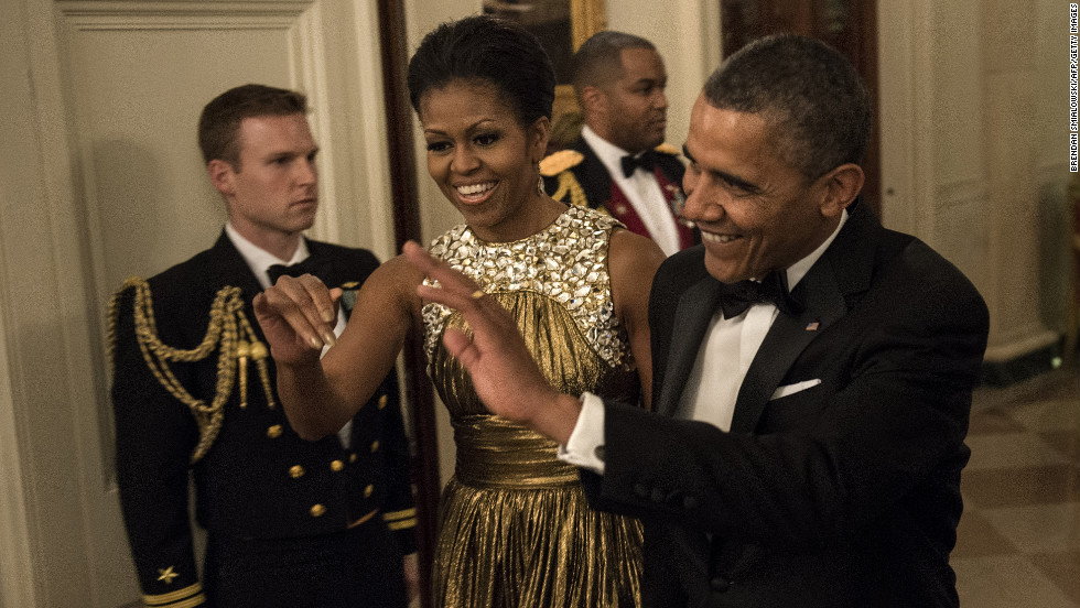 The Obamas arrive for the pre-honors reception Sunday at the East Room of the White House.