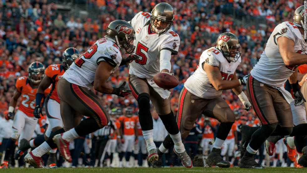 Quarterback Josh Freeman of the Tampa Bay Buccaneers hands the ball off to running back Doug Martin in their game against the Denver Broncos on Sunday.