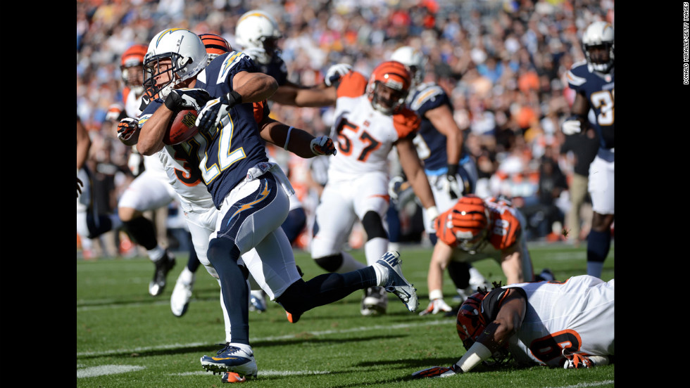 Chris Carr of the San Diego Chargers returns the ball against the Cincinnati Bengals on Sunday.