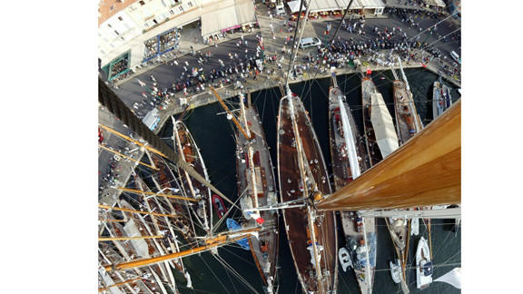 """Kos photographed Saint Tropez harbor from the top of 52 meter schooner Eleonora. """"Whilst guest and crew were chatting on deck and strollers gathered on the promenade, I donned a harness and was hoisted 45 meters aloft,"""" she said."""
