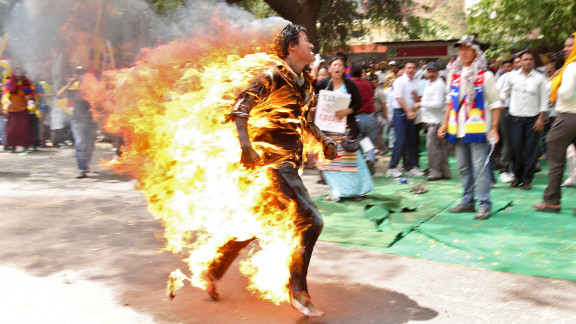 March 26: A Tibetan exile runs after setting himself on fire in New Delhi, India, during a protest against Chinese President Hu Jintao