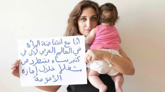 """The Uprising of Women in the Arab World photo campaign asked supporters to submit photos of themselves holding signs supporting the demands of Arab women. """"I am with the uprising of women in the Arab world because many women get fired during their maternity leave,"""" wrote Shereen, from Lebanon."""