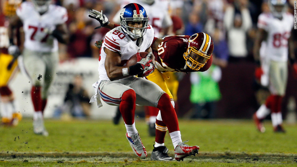 Victor Cruz of the New York Giants runs after a first-down catch on Monday against the Washington Redskins.