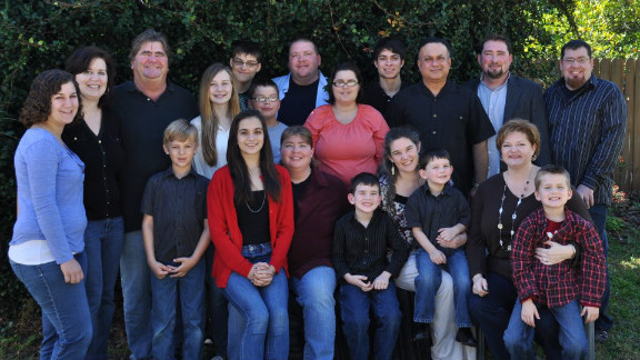 Portrait of a blended family: Natalie and David Kizelewicz (second and third from left) with their children and grandchildren.