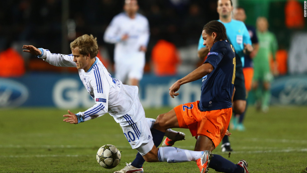 Daniel Congre of Montpellier challenges Teemu Pukki of Schalke during the 1-1 draw in France. The point was enough for the German side to top Group B ahead of Arsenal, which was beaten by Olympiakos.
