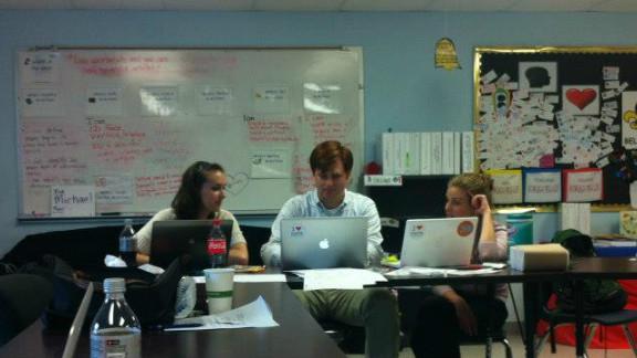 Kickboard CEO Jennifer Medbery, right, meets with engineer Christian Burck and Brenna Benson, of KIPP charter schools.