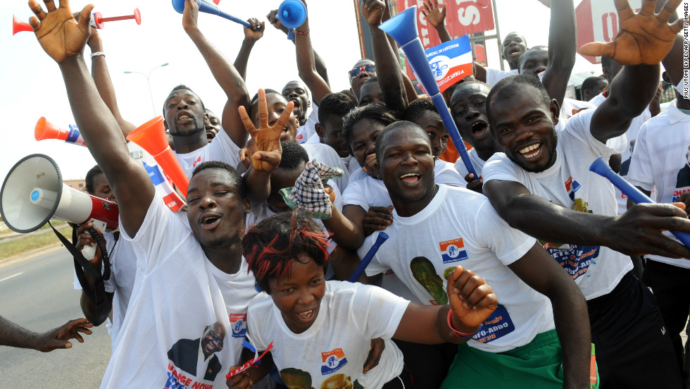 Mahama will be up against NPP candidate, Nana Addo Dankwa Akufo-Addo, who is running for president for the third time, having run in 2008 and 2012. <br /><br />Pictured: NPP supporters dance in the streets of Kasoa in December 2012.