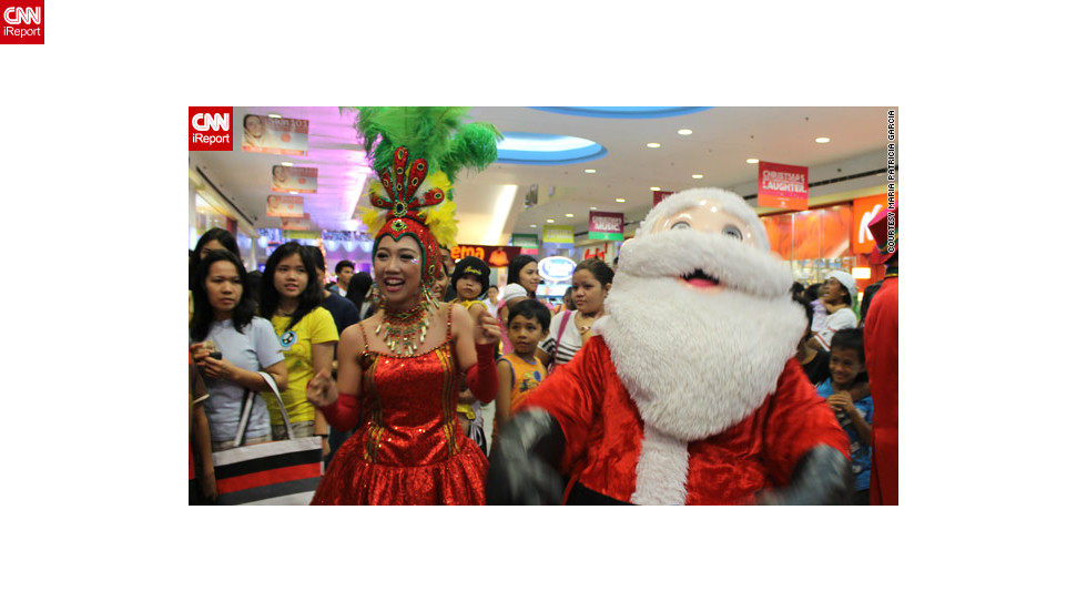 "A wacky Christmas parade with dancers, mascots and of course <a href=""http://ireport.cnn.com/docs/DOC-889604"">Santa Claus</a> caught iReporter Patricia Garcia's eye during a shopping trip to a local mall."