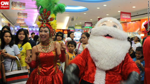 A wacky Christmas parade with dancers, mascots and of course Santa Claus caught iReporter Patricia Garcia