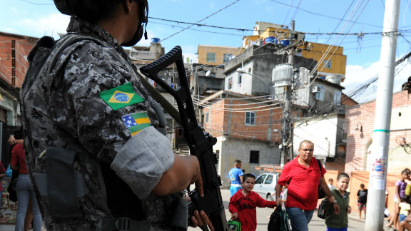The Brazilian government has implemented programs to control violence in shantytowns around the country. Here an officer patrols one of Rio de Janeiro