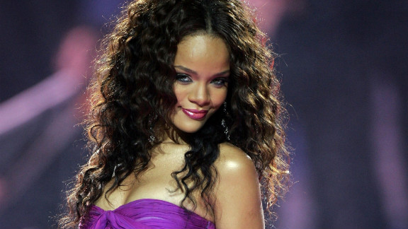 Dressed in a purple gown, Rihanna performs during the 2006 World Music Awards in London.