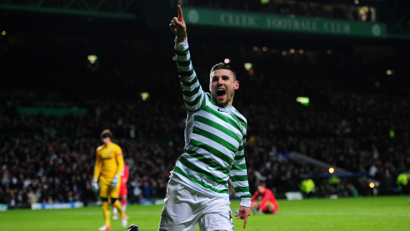 Gary Hooper and Kris Commons were the stars as Celtic claimed a 2-1 win over Spartak Moscow to clinch its place in the knockout phase.  Hooper