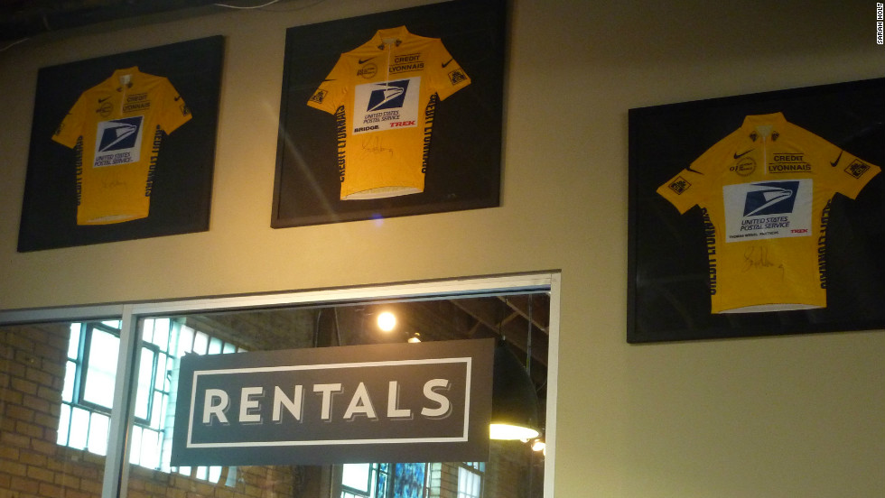 Three of Armstrong's yellow jersey hang inside Mellow Johnny's.