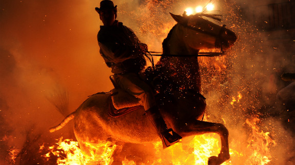 January 16: A man rides a horse through a bonfire in the small village of San Bartolome de Pinares, Spain, in honor of San Anton, the patron saint of animals.