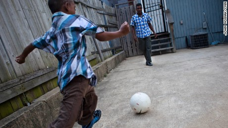 A Bangladeshi boy plays soccer with his father in Baltimore, Maryland. The boy was attacked and mutilated in Dhaka in 2010 and was later brought to the U.S., where doctors at Johns Hopkins Children's Center agreed to operate on him for free.