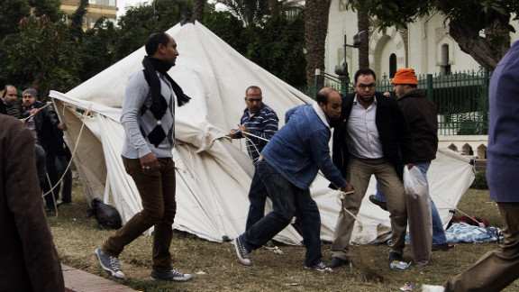 Members of the Muslim Brotherhood and Morsy supporters destroy tents of anti-Morsy protesters outside the presidential palace on December 5.