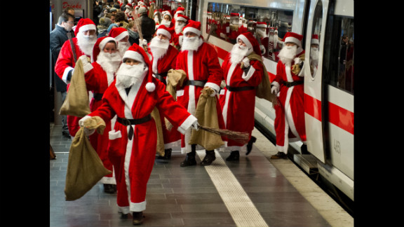 Around 400 people dressed as Santa Claus arrive by train in Frankfurt am Main, Germany, on December 6.