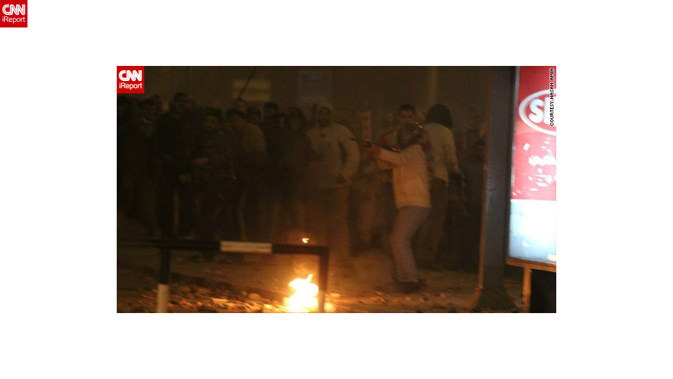 "On December 5, pro- and anti-Morsy protesters fought bloody battles on the streets outside the palace. Several deaths have been reported and hundreds of people have been injured, authorities say.  iReporter Hasan Amin said <a href=""http://ireport.cnn.com/docs/DOC-891413"">in this image</a>, a pro-Morsy supporter pointed what appears to be a rifle at protesters on the opposing side. The military rolled tanks into protest flashpoint areas, but many fear more violence ahead of a planned constitutional referendum on December 15."