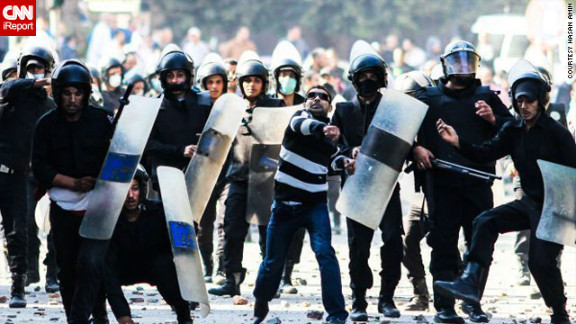 Police, and some men not in uniform, charged at protesters amid a hail of stones and ripped-up pavement cement blocks in this image by Hasan Amin from November 27. At least 35 officers have been injured in the various protests.