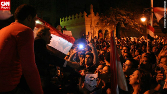 """By December 4, protests had gotten larger and anti-government demonstrators <a href=""""http://ireport.cnn.com/docs/DOC-891041"""">marched on the presidential palace</a> in Cairo, as seen in this image by iReporter Maged Eskander. Crowds shouted """"liar"""" in reference to Morsy and chanted anti-Muslim Brotherhood slogans."""