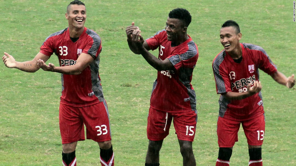 Mendieta (left) celebrates with Persis Solo teammates Romuald Noah and Yanuar Ruspuspito after scoring in a match against Persip Pekalongan.