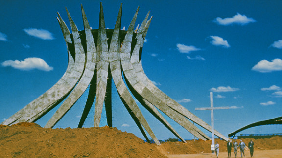 """The cornerstone of Niemeyer's <a href=""""http://catedral.org.br/historia"""" target=""""_blank"""" target=""""_blank"""">Cathedral of Brasilia</a> was laid in 1958. This hyperboloid structure consists of 16 concrete pillars, each weighing 90 tons, and covers a circular area that is 70 feet in diameter. This photo was taken in the 1960s, but the building was finally inaugurated in 1970."""
