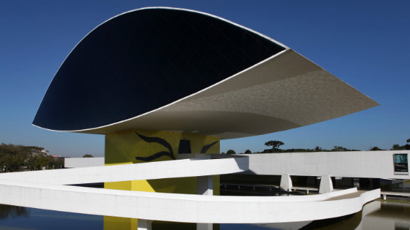 """The first building of the <a href=""""http://www.museuoscarniemeyer.org.br/institucional/sobre-mon"""" target=""""_blank"""" target=""""_blank"""">Oscar Niemeyer Museum</a> was designed by him in 1967. The museum, located in Curitiba, Brazil, first opened in 1978, but more than two decades later, further expansions were made and the museum was reopened in 2003."""