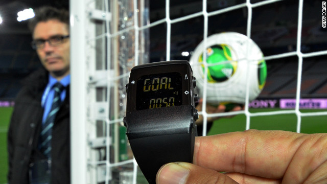 A FIFA official displays new goal-line technology, developed by GoalRef, for the press in Yokohama on December 5, 2012 ahead the Club World Cup football tournament beginning on December 6. The wrist watch displays 'goal' and vibrates whenever the ball enters the goal. Referees can reject the use of goal-line technology or even overrule it in the Club World Cup, which starts this week in Japan, a senior FIFA official said on December 5. AFP PHOTO / Yoshikazu TSUNO (Photo credit should read YOSHIKAZU TSUNO/AFP/Getty Images)