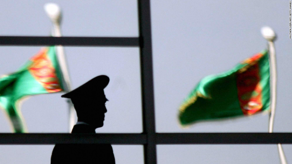 A Turkmen policeman stands in front of the People's Congress in 2007.