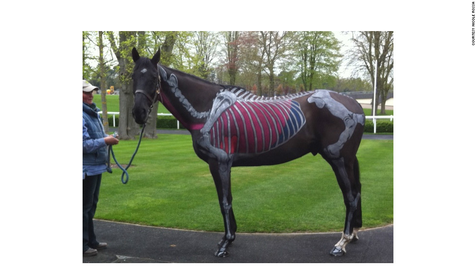The carefully painted horses are displayed at races and equine teaching events across Britain, such as this horse by massage therapist Nicole Rossa.