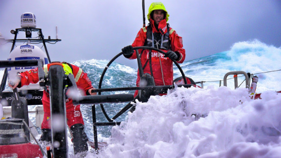 """""""It's an investment to have the right camera equipment that can withstand the salt water,"""" award organizer Bernard Schopfer said. Photographer Hamish Hooper was well prepared when he took this image of sailors battling waves in the Southern Ocean."""