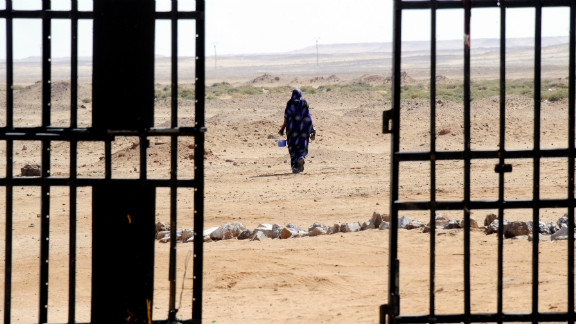 A Sahrawi woman walks in the desert in March 2011 near the Western Sahara refugee camp in Tindouf.