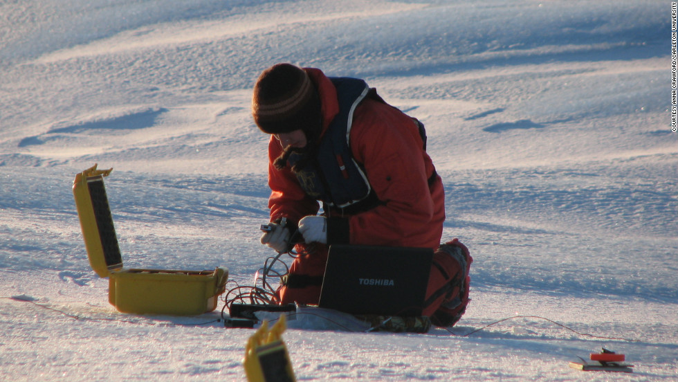 Anna Crawford of Carleton University sets up instruments to measure thickness of an ice island. Mueller says that in 2011 alone, 3 billion tons of ice broke away from Canada's major ice shelves on the northern coast of Ellesmere Island.
