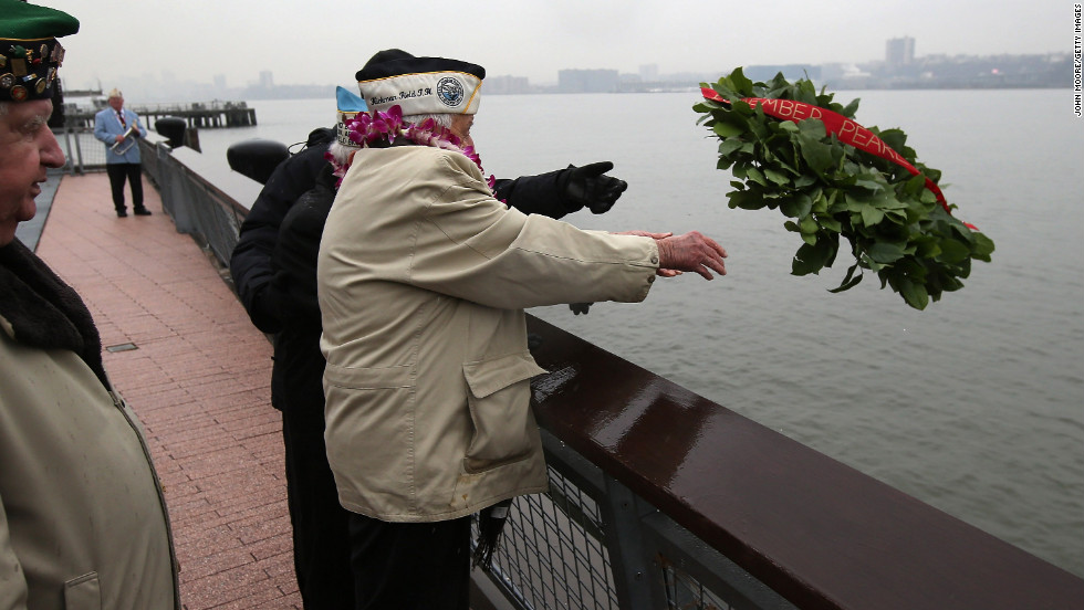 Pearl Harbor survivors throw a wreath into the Hudson River in New York. World War II veterans from the New York metropolitan area participated in a wreath-laying ceremony next to the Intrepid Sea, Air and Space Museum, which was damaged in Hurricane Sandy and is undergoing repairs.