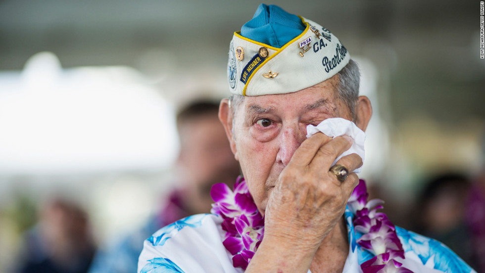Pearl Harbor survivor Victor Miranda wipes his eyes during a commemorative ceremony in Pearl Harbor, Hawaii.