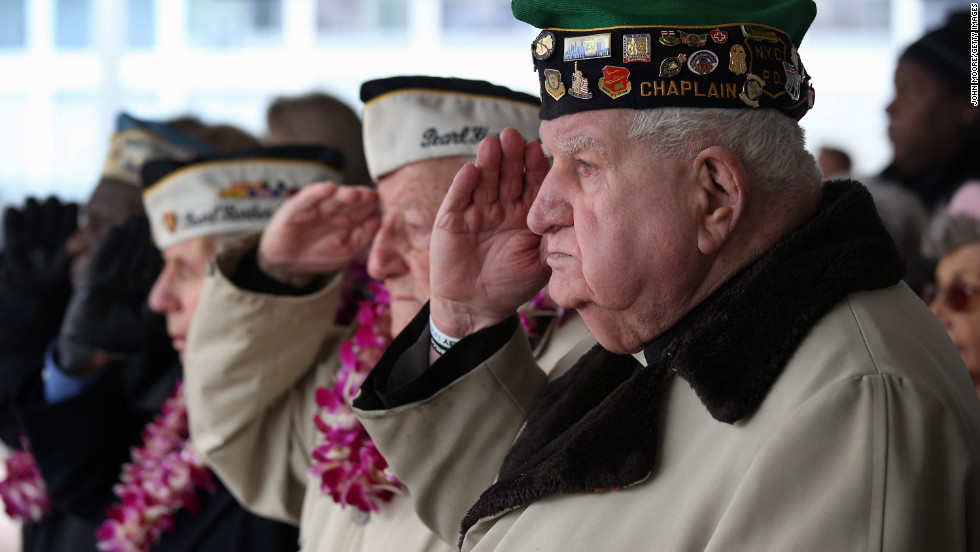 Survivors salute during a memorial service in New York.