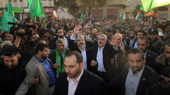 Hamas leader-in-exile Khaled Meshaal and Hamas PM in Gaza Ismail Haniya  wave to supporters in Gaza City, December 7, 2012.