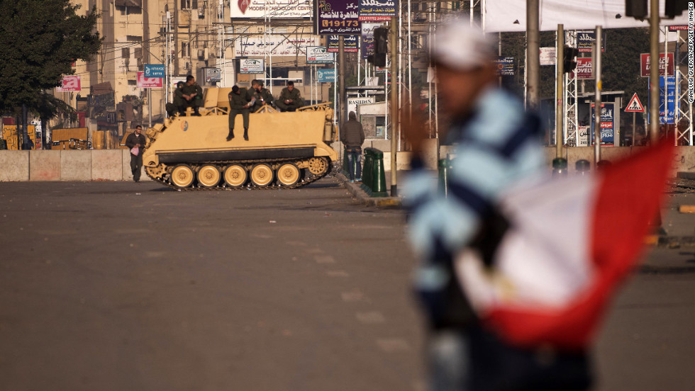 Egyptian soldiers take position on a road leading to the presidential palace on December 8.