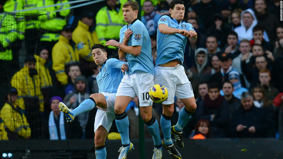 Manchester City midfielder Samir Nasri (left) diverted Van Persie's free kick past Hart as he backed off from his position in the defensive wall.