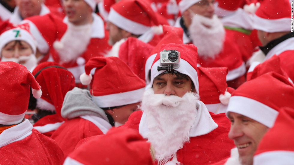 Participants in the fourth annual Michendorf Santa Run, one wearing a camera on his head, gather shortly before the run on December 9 in Michendorf, Germany. More than 800 people took part in this year's races.