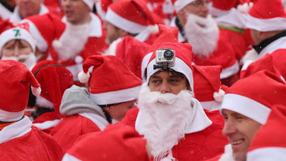 Participants in the fourth annual Michendorf Santa Run, one wearing a camera on his head, gather shortly before the run on December 9 in Michendorf, Germany. More than 800 people took part in this year