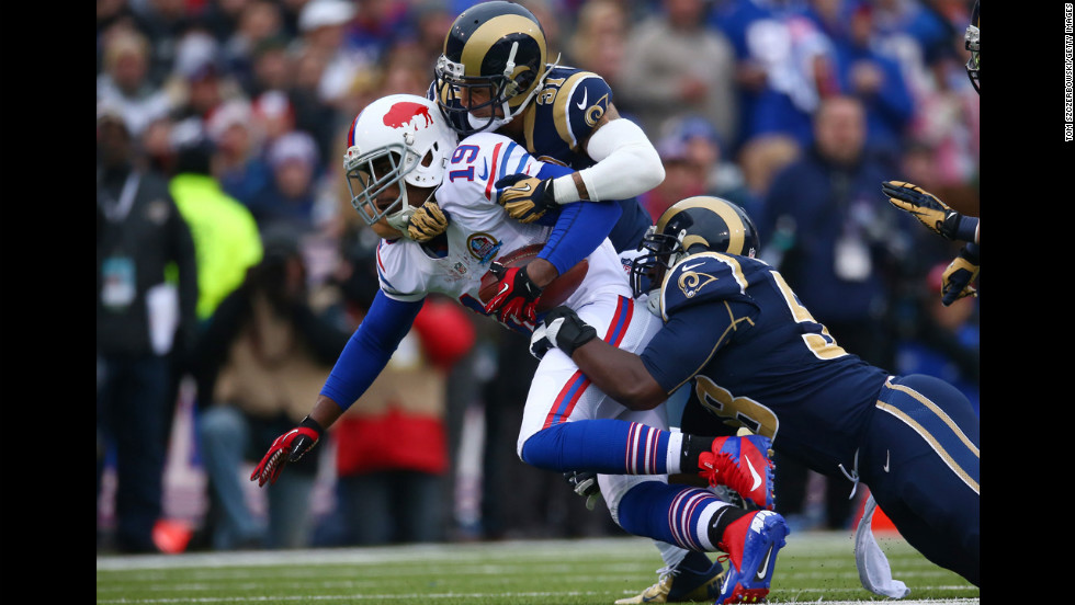 Bills wide receiver Donald Jones is tackled by Cortland Finnegan of the Rams on Sunday.