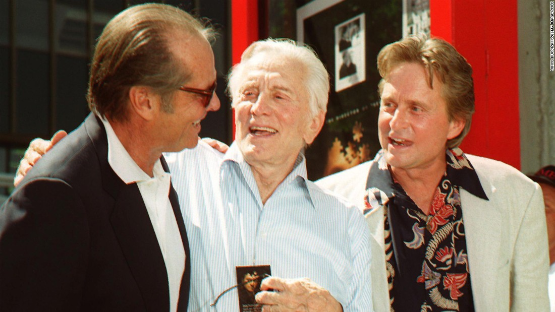 Actor Jack Nicholson greets Kirk Douglas after a ceremony honoring son Michael at Grauman's Chinese Theatre in 1997. Michael Douglas placed his hands and footprints in cement at the Hollywood landmark.