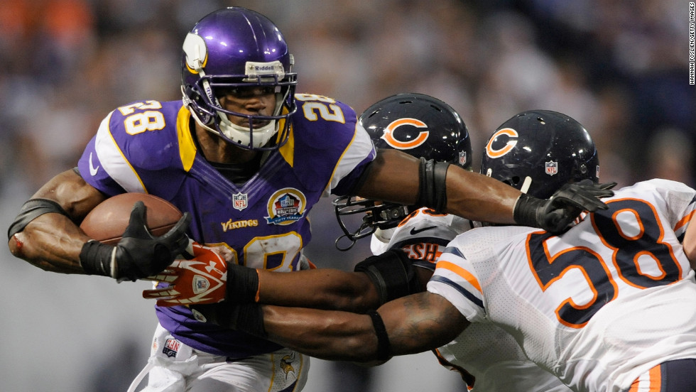 Minnesota Vikings running back Adrian Peterson carries the ball against No. 53 Nick Roach and No. 58 Dom DeCicco of the Chicago Bears during the fourth quarter on Sunday, December 9, at Mall of America Field at the Hubert H. Humphrey Metrodome in Minneapolis, Minnesota. The Vikings defeated the Bears 21-14.