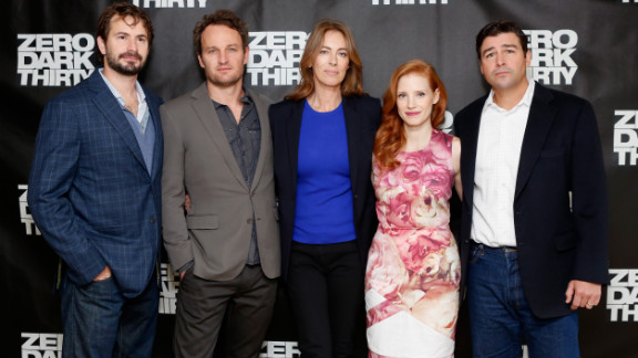 """Screenwriter Mark Boal, left, and director Kathryn Bigelow, center, pose with cast members of """"Zero Dark Thirty."""""""